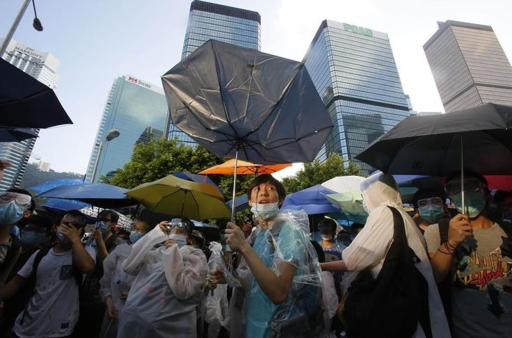 "With so many protesters using umbrellas to shield themselves from police tear gas attacks, the term ""Umbrella Revolution"" took off on global social media to describe the occupation. The phrase has also been censored. 