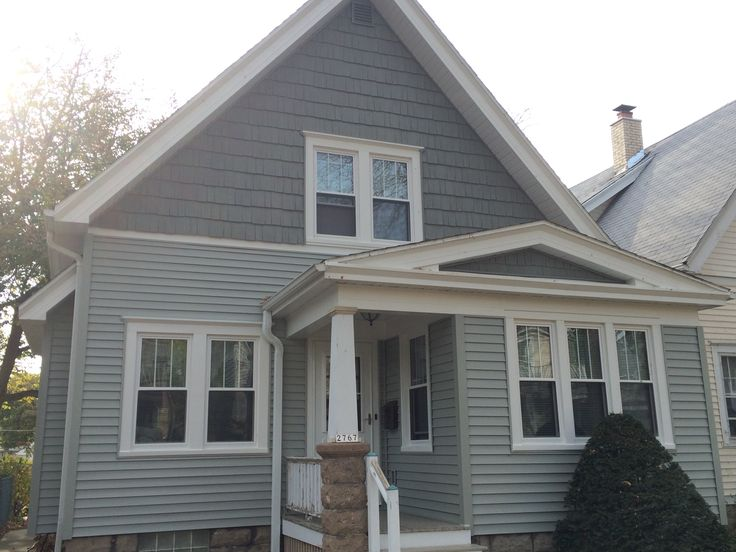 """This project consisted of side and trim, windows and gutters. We used Mastic Quest vinyl Siding 4"""" exposure, Mastic Cedar Discovery vinyl hand split cedar shake , Quality Edge aluminum soffit and fascia system in white.  You can find out more about this project by calling us."""
