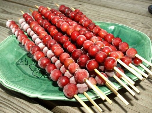 grapesicles! I love this idea! We love eating frozen grapes here. As soon as they get the slightest bit smushy my kids pop them in the freezer. I think I will buy some skewer sticks and pop these in the freezer late at night for a fun surprise when the snack blues hit!