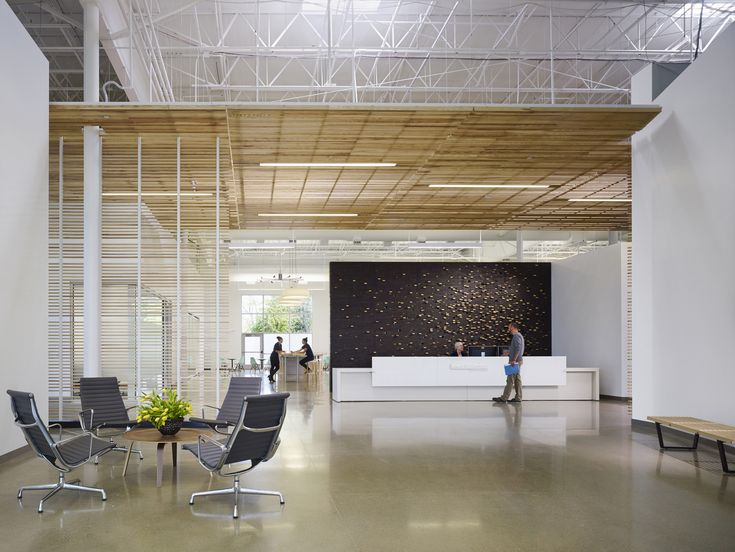 Perkins+Will designed a 40,000-square-foot space with extremely high ceilings, exposed beams, and a latticework canopy. | Newell Rubbermaid – Kalamazoo Design Center by Perkins+Will
