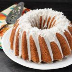 A recipe for a pina colada bundt cake. Pineapple and coconut flavors give a tropical flare to a cake baked in a bundt pan.