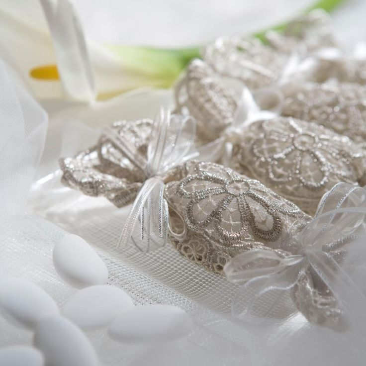 Fancy Wedding Favors - fine Italian lace doily wraps five jordan almonds signifing five wishes for the bride and groom: health, wealth, happiness, fertility, and longevity. Caprai Lace, Italy