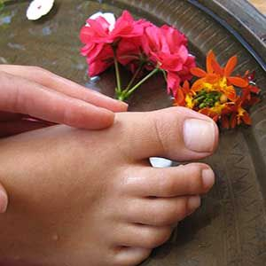 REFLEXOLOGY FOOT MASSAGE Include  Warm aromatherapy foot bath. Exfoliation. Cuticle and nail grooming