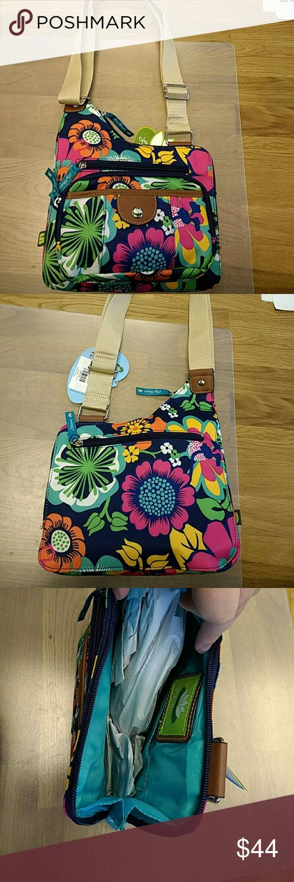 """Lily Bloom Crossbody Bag Lily Bloom Brenda crossbody bag in floral print. Material is their signature fabric made from recycled plastic bottles. 11""""H x 9.25""""W x 1""""D Adjustable strap, approx. 25"""" Top zipper closure. Three exterior zippered pockets. One interior pocket and one interior tab pocket. Lily Bloom  Bags"""