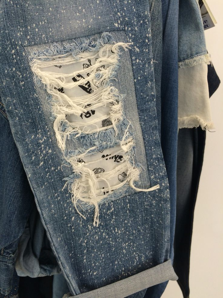 patchwork denim with damages and conversational print lining, Girlfriend fit jeans, splatter bleach wash. www.unionmill.com woven garment supplier in shanghai