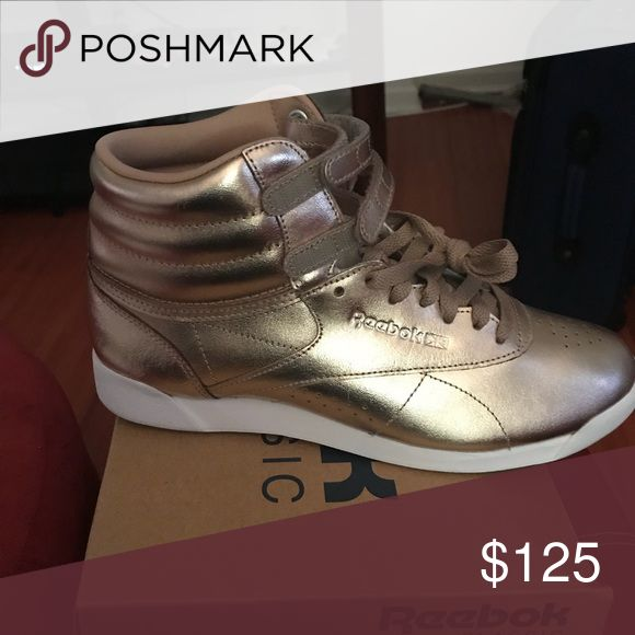 Size 9 Reebok brand new Size 9 Reebok brand new in the box 125$ color gold Reebok Shoes Athletic Shoes