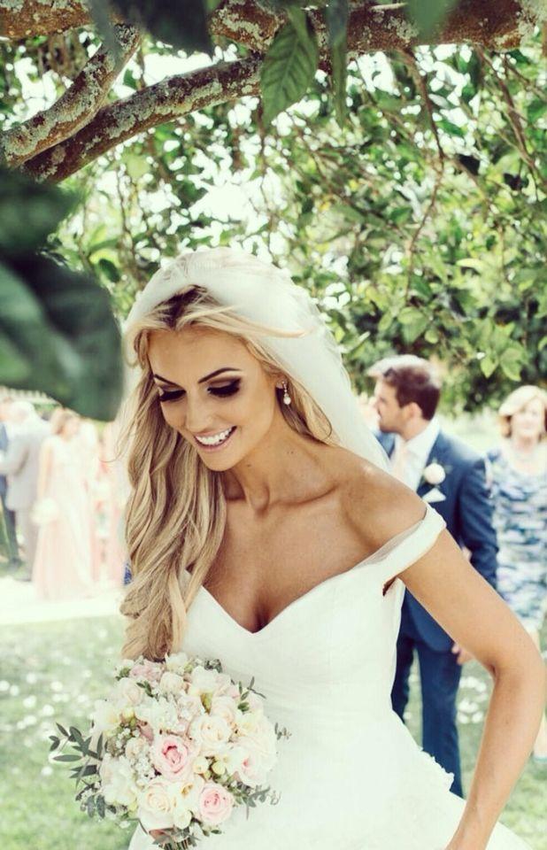 Rosanna Davison's wedding dress = off the shoulder wedding dress with straps. I love this neckline