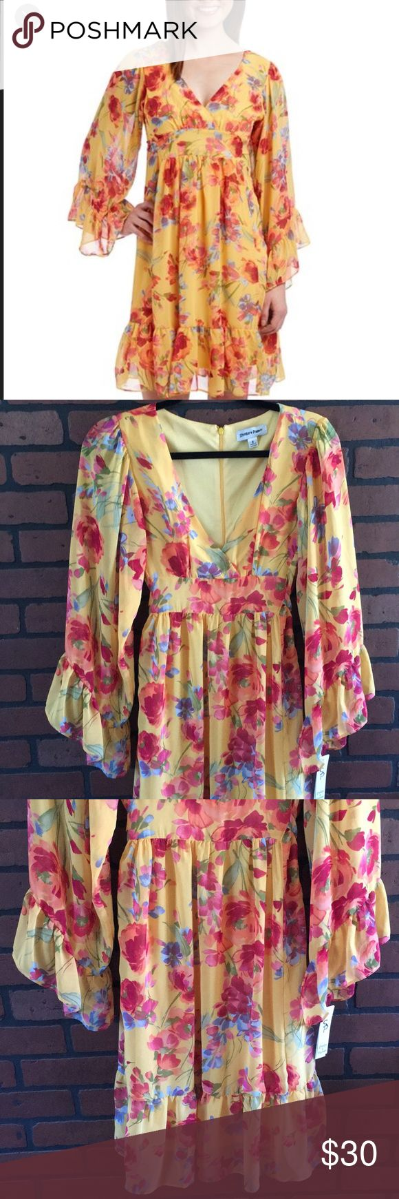 """Shelby & Palmer dress💛 NWT💛 flowy bell sleeve dress💛 Golden with floral print💛 back zip back tie💛 dress is lined 💛sleeves are sheer💛 material is 100% polyester💛 armpit to armpit measures approx 15.5"""" 💛 shoulder to bottom measures approx 38"""" Shelby & Palmer Dresses Midi"""