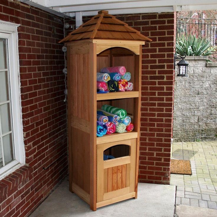 I could make something like this much cheaper, or even find a cheap flea market corner unit or something....  perfect for storing towels, goggles, sunblock, and any other small poolside necessities.