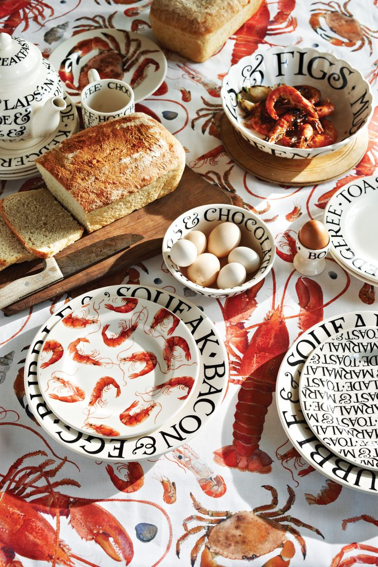 On holiday in Norfolk, Matthew bought a feast of shellfish for lunch – and couldn't resist drawing it. The result was our Shellfish pattern, and this beautifully illustrated tablecloth compliments the rest of the collection which includes the Lobster platter, 8 and a half inch plates and matching tea towel. #EmmaBridgewater #Shellfish