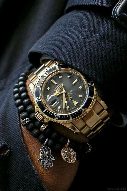 Oyster Perpetual (Negro y Oro) con pulsera. Rolex