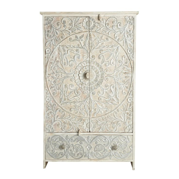 Indian Silver Wardrobe Namaste: Recreate a gentle oriental atmosphere with the Namaste white Indian cupboard. This cupboard in sculpted wood is decorated with a large rosette motif on its 2 doors. Made by craftsmen, this storage unit offers you 3 shelves and a large drawer. Whitewashed by hand, each white and silver cupboard is a unique piece.