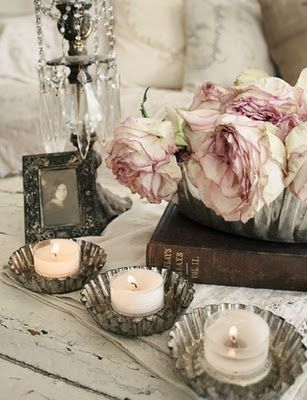 Vintage tart cups as candle holders.