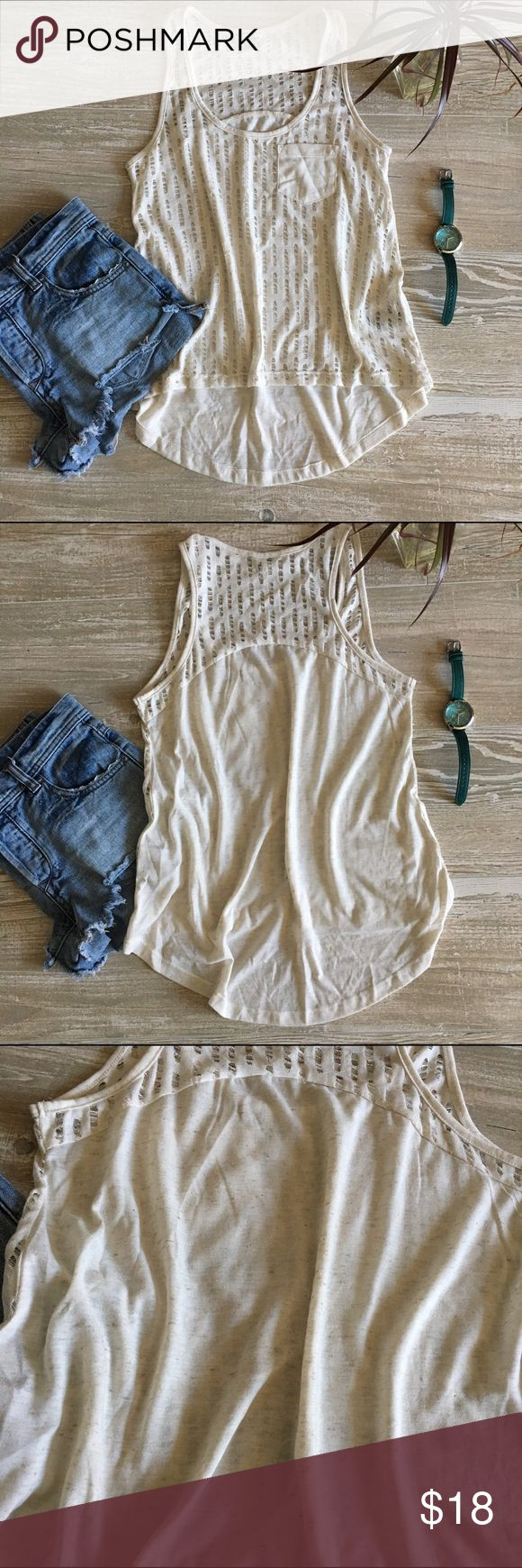 •Guess• Heathered Cream Tank NWOT. This tank is so fun, but I just haven't worn it yet! Layer with a bandeau in the warmer months and your good to go. Features a high low cut with feathered perforation. Back is solid. Size XS. Guess Tops Tank Tops