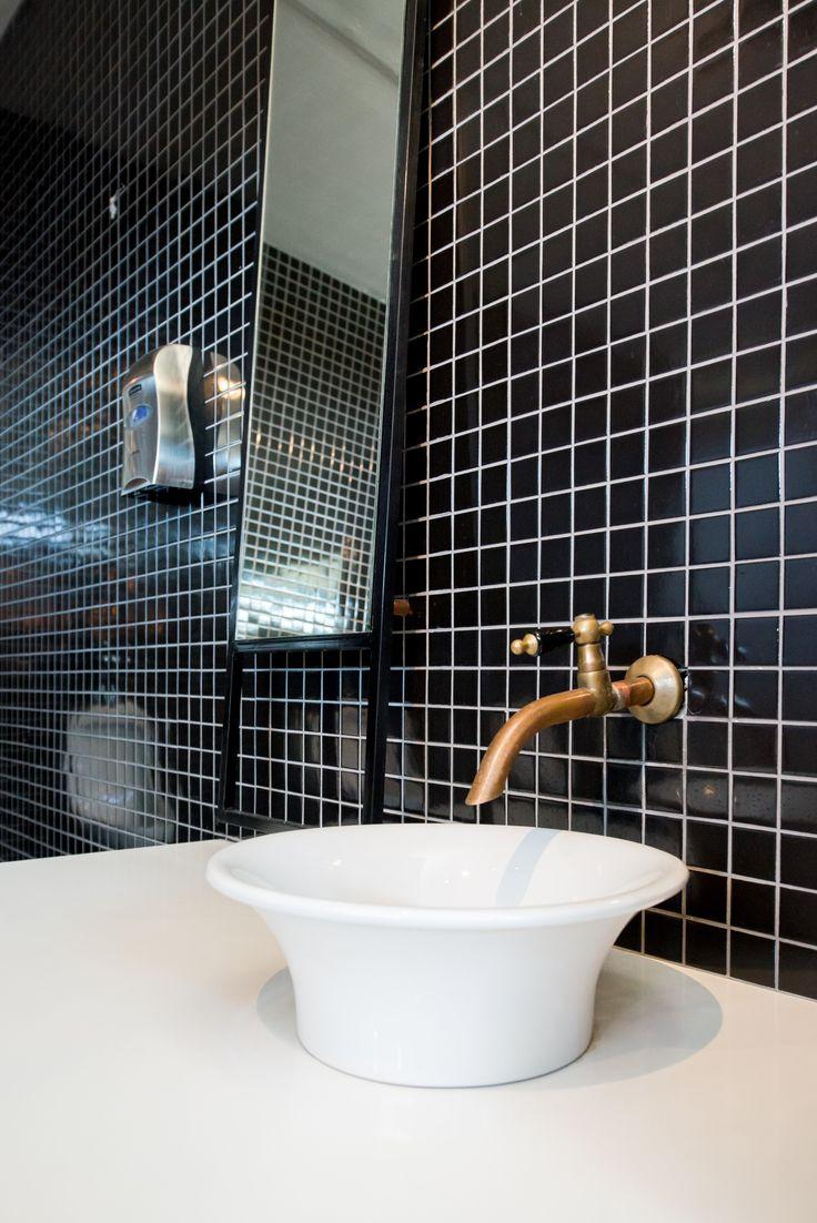 Inhouse Brand Architects executes a modern design for Anura Vineyards' new events venue and bar. #interiordesign #interiors #elegantinteriors #sophisticatedinteriors #eventsvenueinteriors #winefarminteriors #winefarms #southafricanwinefarms #beautifulspaces #bars #barinteriors #bathroominteriors