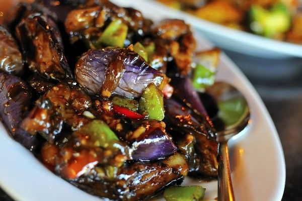 Recipe including course(s): Side; and ingredients: asian chile paste, asian eggplant, basil, cilantro, lime juice, soy sauce, sugar, vegetable oil, water
