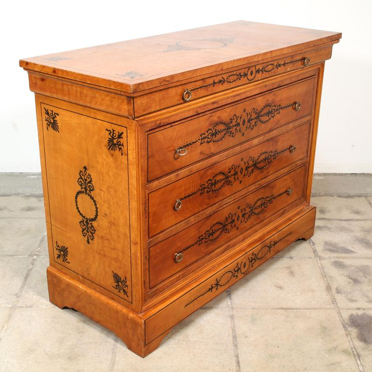 This Charles X inspired chest of drawers is featured in a solid wood with a glossy orange maple finish. This short dresser is in great condition with 3 large drawers, a skinny top drawer and black painted motifs. Simple victorian storage piece perfect for a small space! #victorian #dressers #shortdresser #sandiegovintage #vintagefurniture