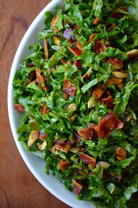 Raw Kale Salad with Warm Bacon Vinaigrette  I added  sliced strawberries  red onion  toasted pecans  amp  bacon