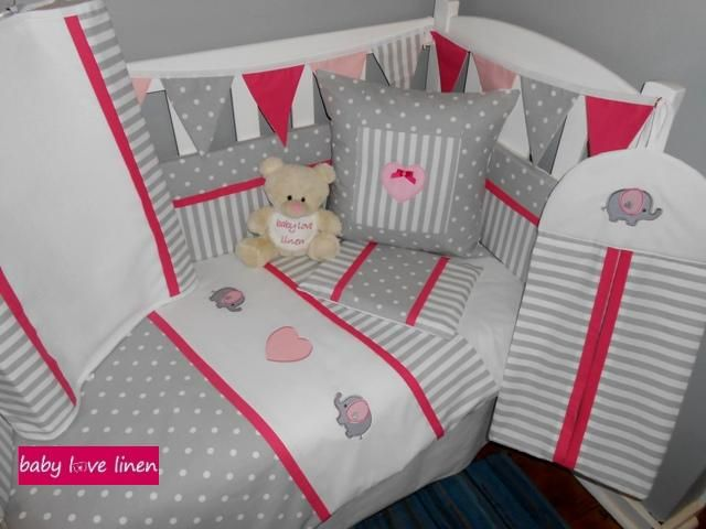 Ellie themed nursery linen in grey/whte stripes and dots with cerise pink accents.