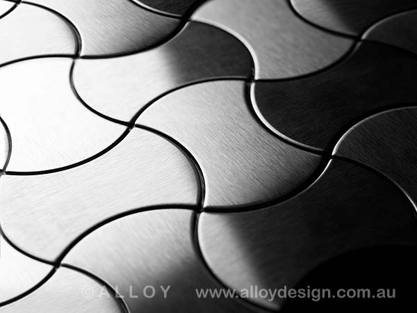 Karim Rashid for ALLOY 'Infinit' tile in brushed stainless steel.