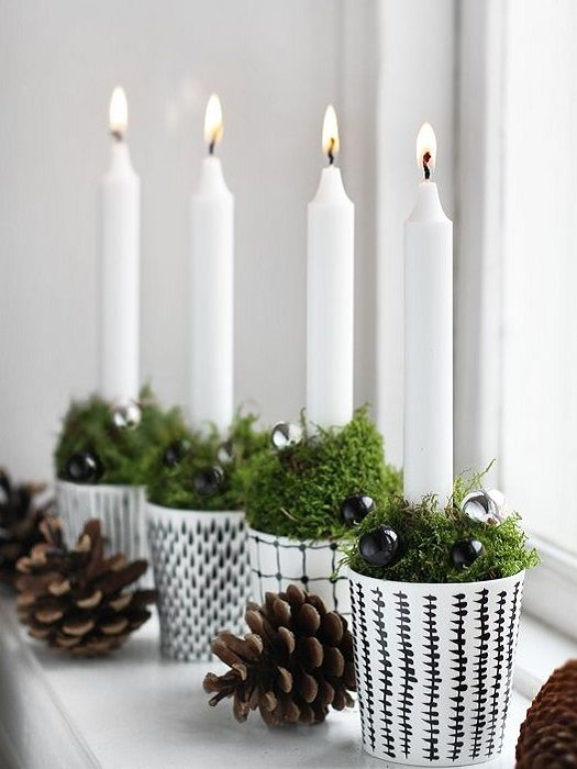 Simple Christmas Decor ... white taper candles in small white candle holders filled with moss and glitter