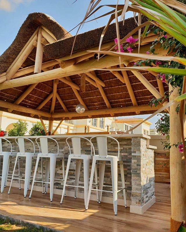 Outdoor Thatched Living Space In A Natural Finish With Timber Decking And Cladded Bar Outdoor Living Space Living Spaces Outdoor Living