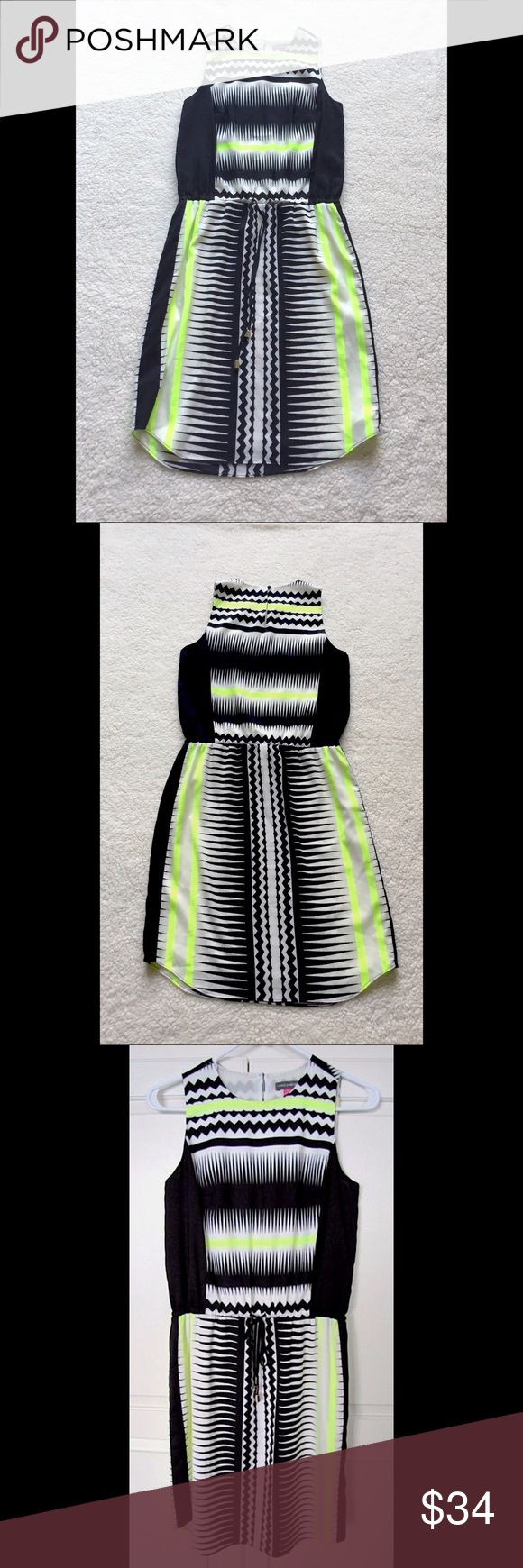Vince Camuto Tie Waist Black & Neon Yellow Dress Vince Camuto Sleeveless Knee-Length Lined Summer Dress Size 2.                                   97% polyester and 3% spandex.               Colors - black, white, neon yellow/green.             Has a tie waist. Has a key hole with button on the back. Vince Camuto Dresses Midi
