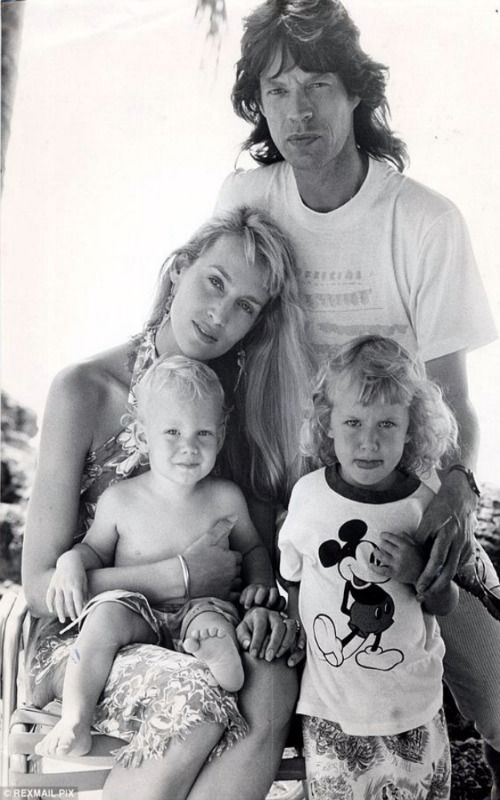 he former model, pictured with ex-husband Mick Jagger and children Elizabeth and James. says her kids are 'grounded'