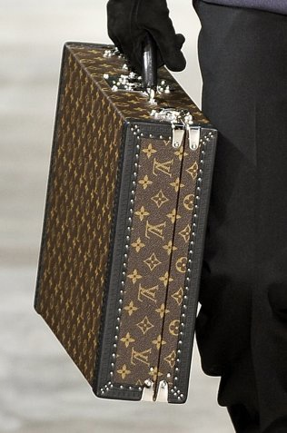 It's a pity that the briefcase has fallen out of vogue with many men in the 21st century, especially when there are dapper and fun ones like this Louis Vuitton Fashion Briefcase. (((sigh)))