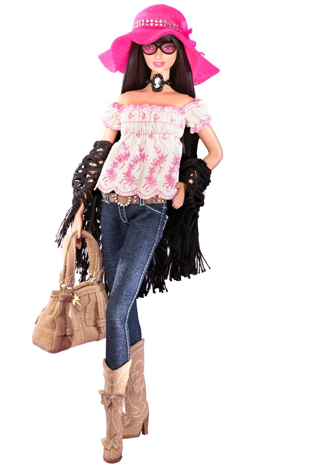 Gold Label®   Release Date: 2/13/20   No more than 7700 units produced worldwide.   Clad in head-to-toe Anna Sui, Anna Sui Boho Barbie® is the picture of Bohemian chic. The look begins with a dainty white blouse with pink embroidered floral details and an empire waist. On top, there's a black, crochet-look shawl straight out of the 1970s! With this, she pairs straight-cut, denim-type trousers tucked into faux suede cowboy boots embellished with butterflies.