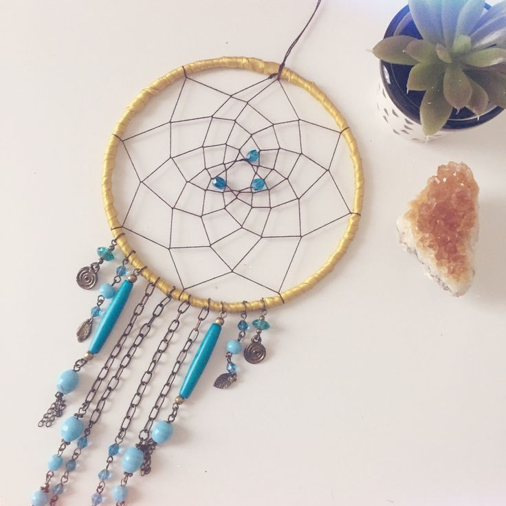 Small gold, bronze and turquoise dreamcatcher with beautiful Moroccan inspired beads. http://www.longlostdreams.com.au/product/suncatcher