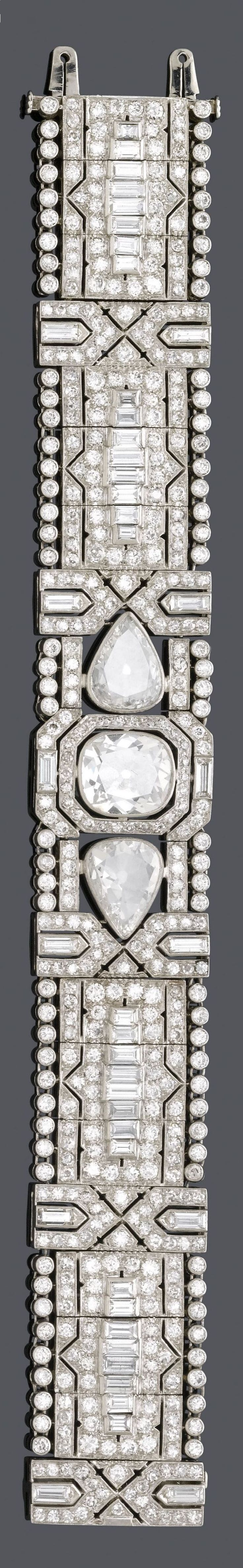 AN ART DECO DIAMOND BRACELET, CIRCA 1930. Set in the centre with one cushion shaped diamond of weighing 2.70 carats and two pear-shaped diamonds, and further set with 44 baguette diamonds, mounted in platinum. #ArtDeco #bracelet