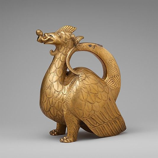 Aquamanile in the Form of a Dragon; copper alloy, North German, circa 1200 - Aquamaniles, which are water vessels used for washing hands, served both liturgical and secular purposes. Those made in the shape of an animal are among the most distinctive products of medieval craftsmen. The most commonly seen zoomorphic aquamaniles are lions, but dragons, griffins, and many other forms were also produced
