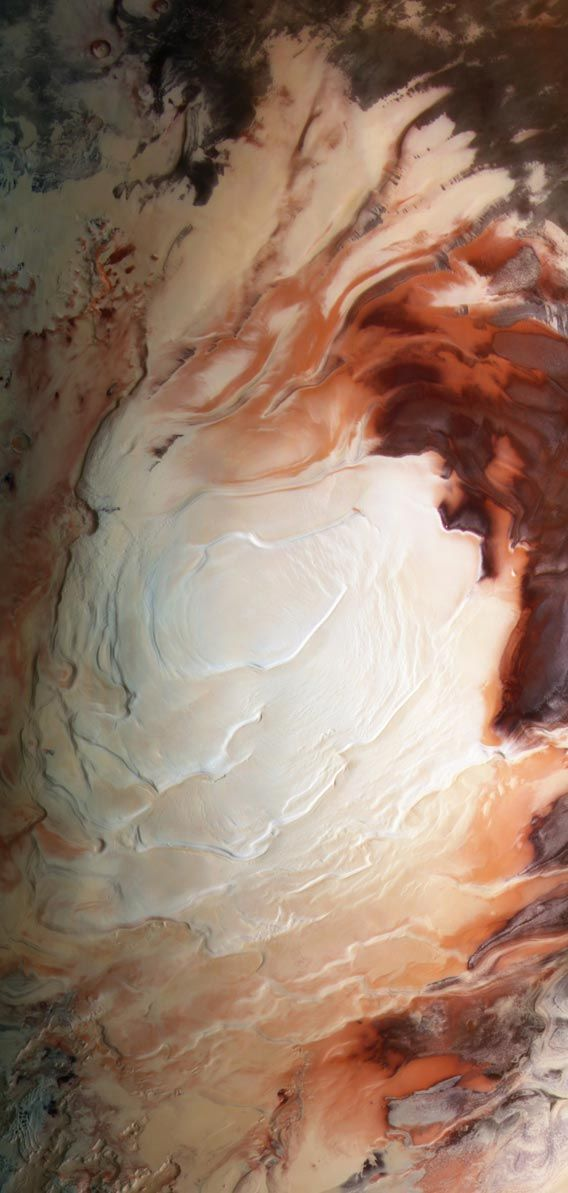The south pole of Mars, like the cream on a latte. Click to enaresenate. Photo by ESA / G. Neukum (Freie Universitaet, Berlin) / Bill Dunford