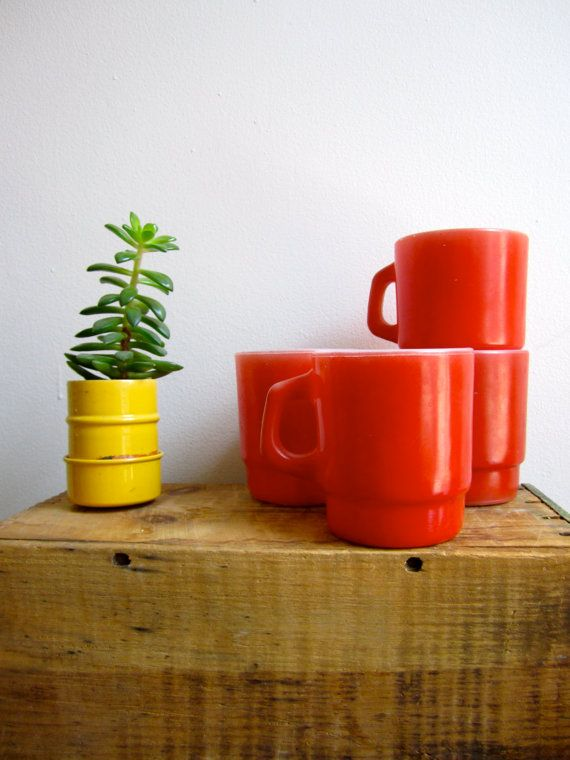 Awesome set of Mugs! Set of 4 bright red mugs by Anchor Hocking. Stacking mugs have a milk glass interior and tomato red exterior. Mugs are in good