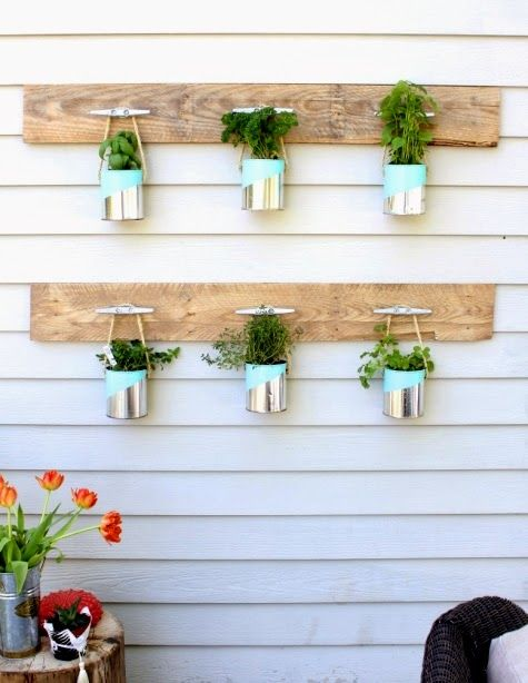 Hanging herb garden in cans nautical style with cleats! Featured on Completely Coastal: http://www.completely-coastal.com/2014/08/nautical-porch.html