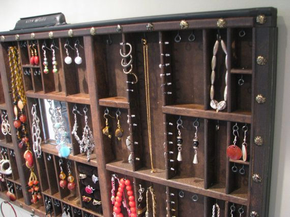 Jewelry Display with stud slots to allow for maximum storage as well as a ring cubby
