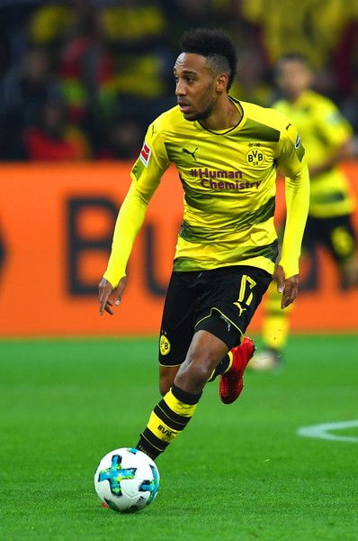 Dortmund's Gabonese striker Pierre-Emerick Aubameyang plays the ball during the German First division Bundesliga football match Borussia Dortmund vs Bayern Munich in Dortmund, western Germany, on November 4, 2017. / AFP PHOTO / PATRIK STOLLARZ / RESTRICTIONS: DURING MATCH TIME: DFL RULES TO LIMIT THE ONLINE USAGE TO 15 PICTURES PER MATCH AND FORBID IMAGE SEQUENCES TO SIMULATE VIDEO. == RESTRICTED TO EDITORIAL USE == FOR FURTHER QUERIES PLEASE CONTACT DFL DIRECTLY AT + 49 69 650050.