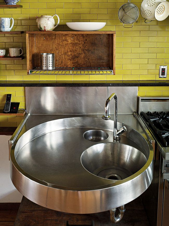 Architect Anne Griswold Tyng's design for a custom stainless steel kitchen sink, which is inset with a mixing bowl and bucket. Photo by Annie Schlechter