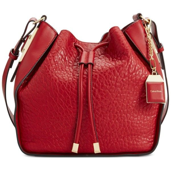Calvin Klein Leather Drawstring Bag found on Polyvore featuring bags, handbags, dark cherry, red drawstring bag, genuine leather handbags, cherry purse, leather purse and calvin klein handbags