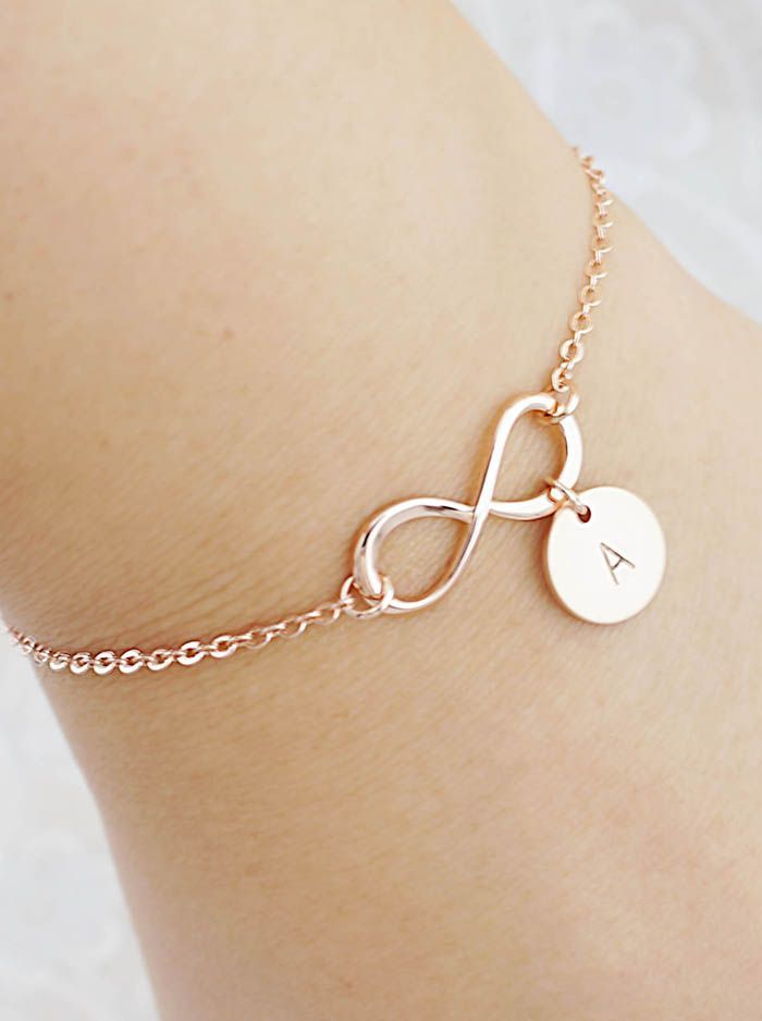 We'll be dropping major hints for this one! Personalized infinity bracelets in Rose Gold from EarringsNation Rose Gold weddings Blush Weddings Infinity bracelet