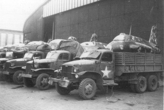American trucks loaded with Me-163 rocket fighters