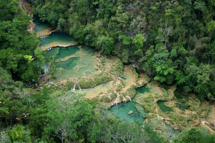 Tiered turquoise pools carved into limestone caves hidden behind a thick canopy of pristine jungle: Semuc Champey is arguably the most mesmerizing highlight in Guatemala.