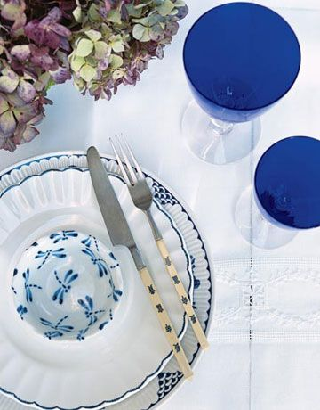 A dragonfly-patterned teacup is combined with vintage Ralph Lauren salad plates, a Danish stoneware dinner plate, and flea-market Chinese flatware.