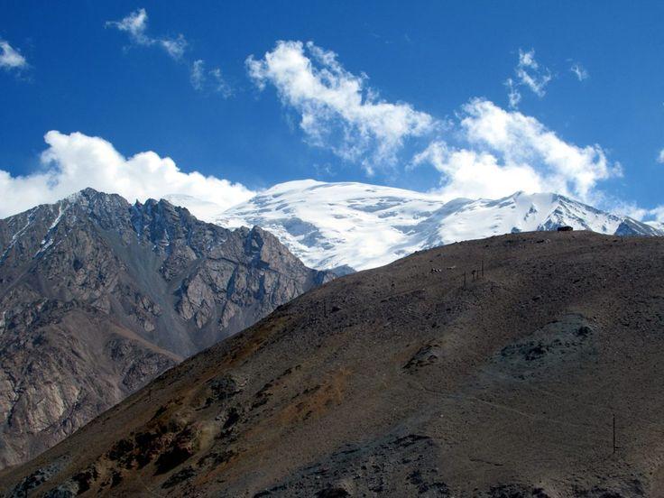 "The eternal snows of the Pamir Mountains (the ""Roof of the World"") rise above the Karakoram Highway between Kashgar and Tashkurgan, Xinjiang, China."