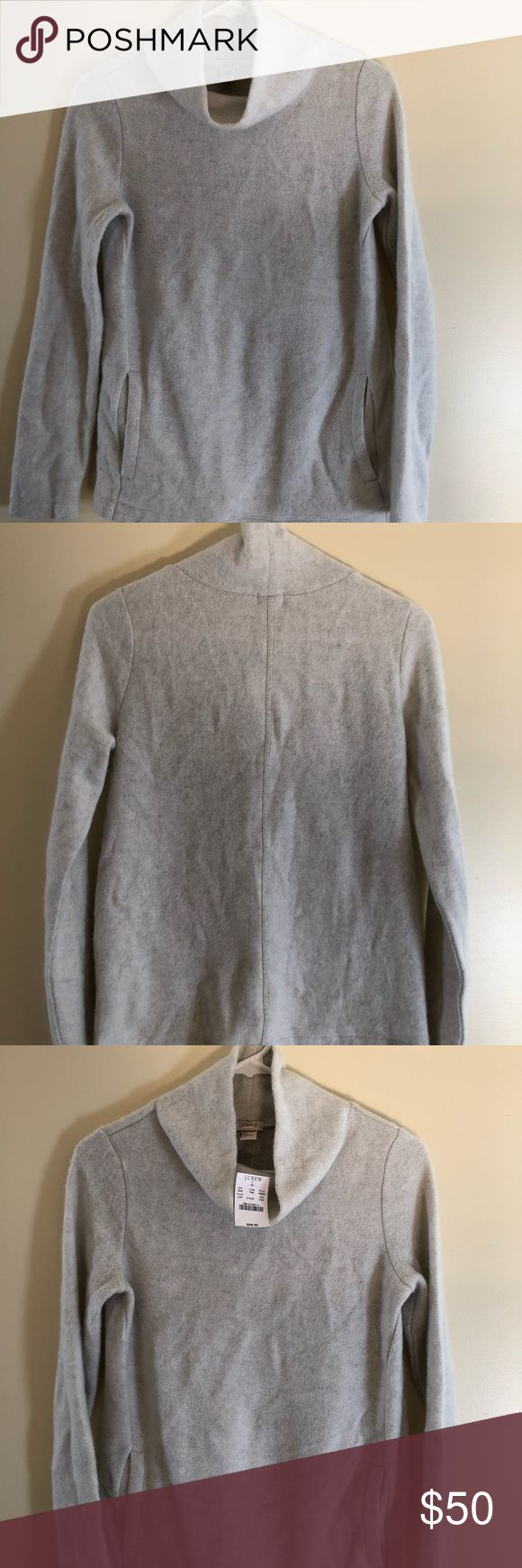 JCREW Fleece Pullover with pockets Size XXS Super cozy fleece pullover in light grey color from JCREW. Cowl neck turtleneck and has pockets! Great layering item for winter. J. Crew Sweaters Cowl & Turtlenecks