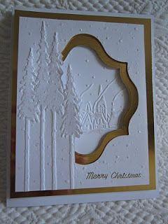Tim Holtz Tall Pines folder, Cuttlebug Snowy Village and the Cuttlebug European Limited Edition Snowflakes folder .
