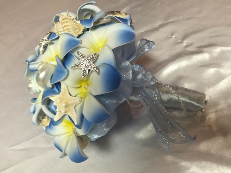 A great option for a beach wedding, this bouquet is made of latex real touch frangipanis and has both natural seashells and sparkling silver brooches.  Frangipanis are available in a number of colours to suit your theme.  All bouquets can be reproduced in the size and colour of your choice. Feel free to mix and match ideas to make your bouquet more individual. Corsage, MOB and Lapel pins are also available to match your colours. Contact leeann@bejewelledbridal.com.au for more information.