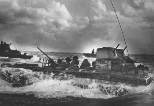 A Water Buffalo, loaded with Marines, churns through the sea bound for beaches of Tinian Island near Guam.  July 1944.