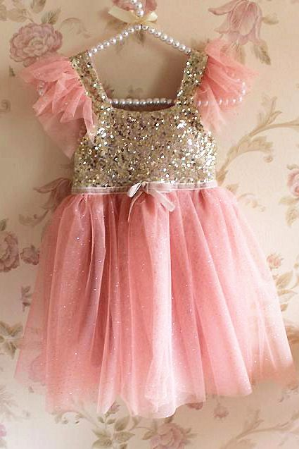 JUST ARRIVED - ONLY A FEW LEFT!! The adorable Ava dress is the newest addition to our Rosettelicious Collection. A statement piece with ever so beautiful sequin and ruffle detailing. Match back with sandals and a head piece to watch your little one stand out at the next party. FEATURES • Full mini gold sequin bodice • Shimmer dusty pink tulle ruffle skirt & sleeves • Textured waist detailing and bow • Invisible back zip • Lined Actual colors may vary due to individual computer ...